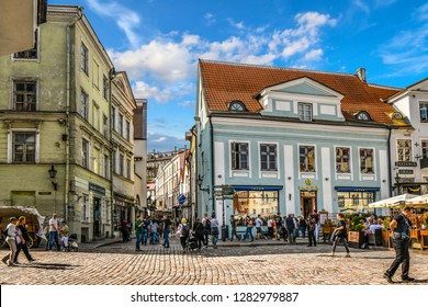 Tallinn, Estonia - September 9 2018: Tourists crowd the sidewalk cafes and shops in the medieval Tallinn Town Square in the walled city of Tallinn Estonia.
