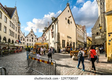 Tallinn, Estonia - September 9 2018: Tourists sightsee and enjoy the shops and sidewalk cafes in the historic Old Town of the medieval city of Tallinn, Estonia on the Baltic Sea.
