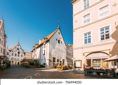 Tallinn, Estonia. Street Cafe Restaurant In Old Town In Sunny Summer Day With Blue Sky
