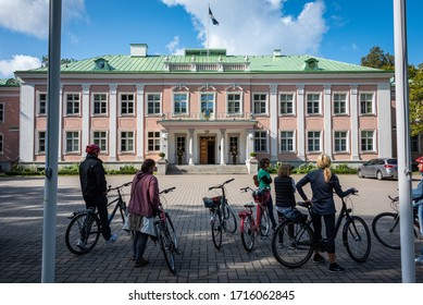 TALLINN/ESTONIA - SEPT. 6, 2020: Photo of tourists with bicyclists looking at the Presidential Palace, located just up the hill from Kadriorg Palace, in Kadrioru Park.