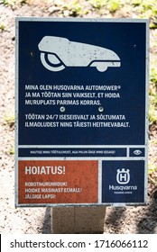 TALLINN/ESTONIA - SEPT. 6, 2020: A photo of a warning sign about an automatic Husqvarna lawnmower, being used in Kadrioru Park.