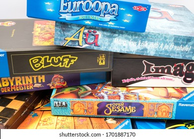Tallinn/Estonia-04.11.2020: Lots of different board game boxes stacked up. Games like Monopoly, Lucor, Labyrinth, Open Sesame, Bluff. Colorful boxes. Corona isolation period activities. Strategy games
