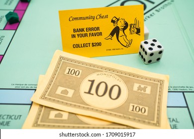 Tallinn/Estonia-04.11.2020: Monopoly board game. Family fun activity during corona outbreak. Bank error in your favor 200$. Community chest card. Yellow monopoly card. Dice in corner.