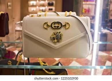 TALY, MILAN - November 1, 2018: Luxury white handbag of a famous brand in store showcase in Milan