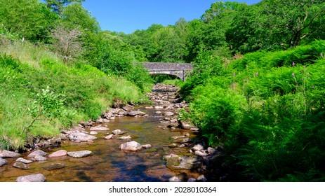 Tal-y-Bont, Wales - July 16, 2021:  The bridge of the Caerfanell at Abercynafon near the reservoir of Tal-y-Bont, Wales