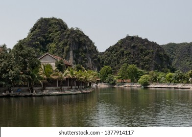Tam Coc, Ninh Binh Province, Vietnam - April 25th, 2016 - Local scenery showing Tam Coc stream and mountains.