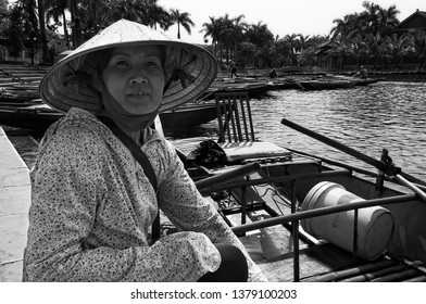 Tam Coc, Ninh Binh Province, Vietnam - April 25th, 2016 - Female rower in Tam Coc. She takes tourists with her row boat to the caves there.