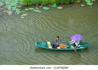 Tam Coc - Ninh Binh - Viet Nam.Tourists traveling in boat along the Ngo Dong River taking picture of the Tam Coc, Ninh Binh, Vietnam. date 07/06/2018
