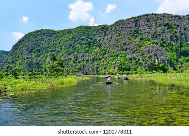 Tam Coc, Ninh Binh, Vietnam.23-4-2018;unidentified tourists are traveling in boat along the Ngo Dong River and taking picture of the Tam Coc
