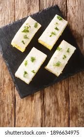 Tamago sandoJapanese egg salad sandwich closeup on the board on the table.