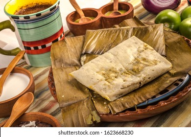 Tamal de Oaxaca, Mexican dish made with corn dough, chicken or pork and chili, wrapped in a banana leaves.