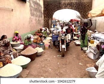 Tamale, Ghana - 5 January 2016: Vendors in a fresh food and grain market in a small town in Ghana, West Africa.