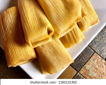 Tamales on a white plate