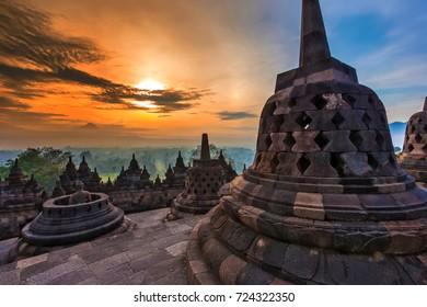 Taman Lumbini park from the height of the temple complex Candi Borobudur at sunrise. Yogyakarta, Jawa, Indonesia.