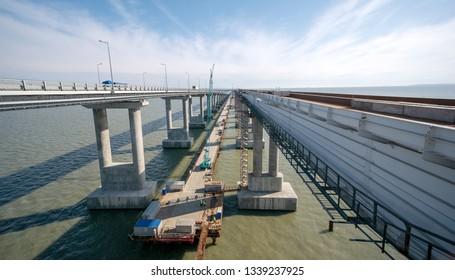 TAMAN, RUSSIA -March 13, 2019: Arch of the Crimean bridge. Construction of the Crimean bridge.March 13, 2019