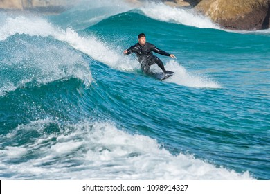 Tamarama Beach, Australia - May 21, 2018. Boogie boarder on a perfect wave at Tamarama Beach