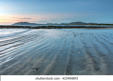 Tamarindo beach at sunset and low tide in Guanacaste, Costa Rica.