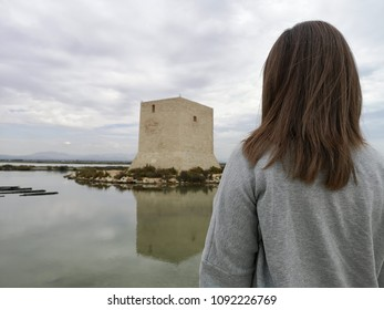 Tamarit tower in the middle of the salt flats with a woman