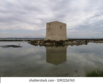 Tamarit tower in the middle of the salt works