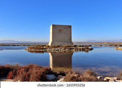 Tamarit tower in the salt flats of Santa Pola. Santa Pola tourism. Historic monument of the Albufera de Santa Pola in the region of Elche, Alicante, Spain. - Shutterstock ID 1655955256