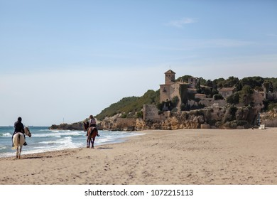 TAMARIT-TARRAGONA,SPAIN-MARCH 8,2012:Mediterranean beach in Costa Daurada area, castle of Tamarit,Tarragona, Catalonia, Spain.