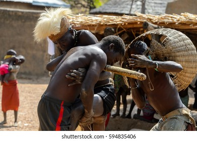 TAMBERMA VIL., TOGO - JAN 13, 2017: Unidentified Tammari men dressed like hunters fight one against the others in the village. Tammaris are ethnic group of Togo and Benin