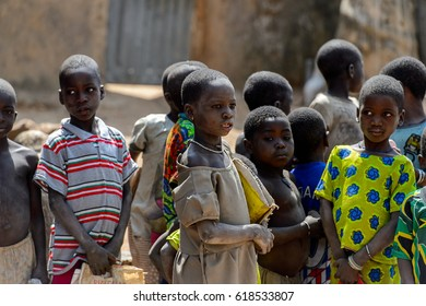 TAMBERMA VIL, TOGO - JAN 13, 2017: Unidentified Tammari many children in colored clothes in the village. Tammaris are ethnic group of Togo and Benin