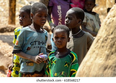 TAMBERMA VIL, TOGO - JAN 13, 2017: Unidentified Tammari children in old clothes in the village. Tammaris are ethnic group of Togo and Benin