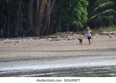 Tambor, Costa Rica - June 22: clam day at the beach with people walking enjoying the day. June 22 2016, Tambor, Costa Rica.