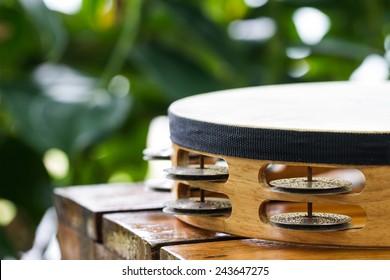 tambourine on wood table in garden