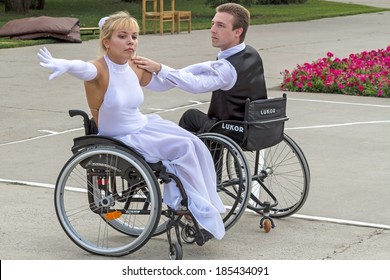 "Tambov City, Russian Federation - August 12, 2012:  An elegant pair of Valery and Elena wheelchair dancing. The festival, entitled ""People with great potential"". Performance in Park City"