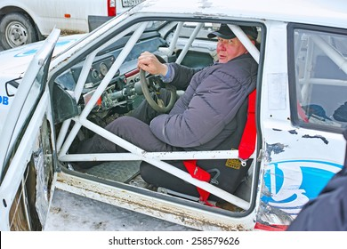 Tambov, Russia - February 21, 2015: Winter car track races on the Cup of the Tambov region. Fedor Chepurov racer behind the wheel of his race car before the start. The quality of medium format