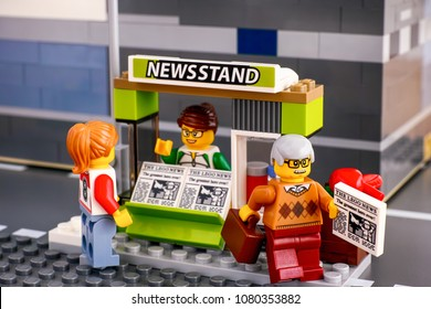 Tambov, Russian Federation - April 21, 2018 Lego newsstand with newspapers and customers. Studio shot.