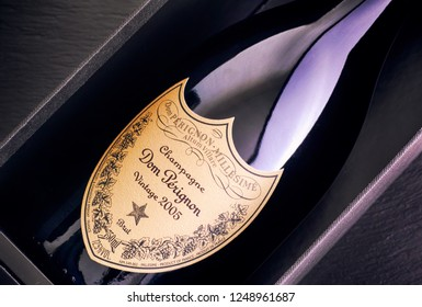Tambov, Russian Federation - August 14, 2018 Close-up of Bottle of Champagne Dom Perignon Vintage 2005 in box. Black background. Studio shot.