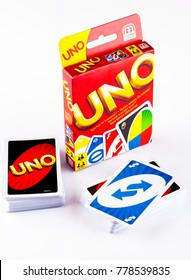 Tambov, Russian Federation - August 15, 2013 Two decks of UNO game cards with UNO game box on white background. Studio shot