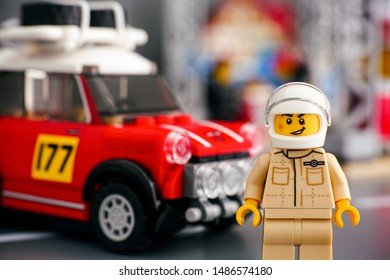 Tambov, Russian Federation - August 18, 2019 Lego 1967 Mini Cooper S Rally driver minifigure by LEGO Speed Champions against his car.