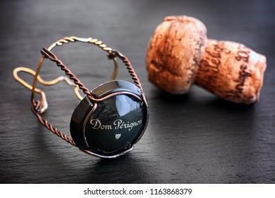 Tambov, Russian Federation - August 19, 2018 Dom Perignon Champagne cork and muselet with cap on black background. Studio shot.