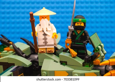 Tambov, Russian Federation - August 19, 2017 Lego Ninjago Movie. The Green Ninja and Wu standing on Green Ninja Mech Dragon and ready to fight. Studio shot.