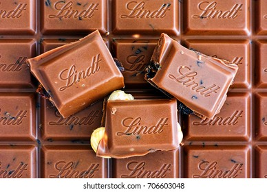 Tambov, Russian Federation - August 26, 2017 Lindt Swiss Classic Gold Milk chocolate with raisins, hazelnuts and almonds.