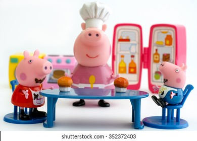 Tambov, Russian Federation - December 16, 2015 Peppa Pig and George Pig sit at the table on Granny Pig kitchen. White background. Studio shot.