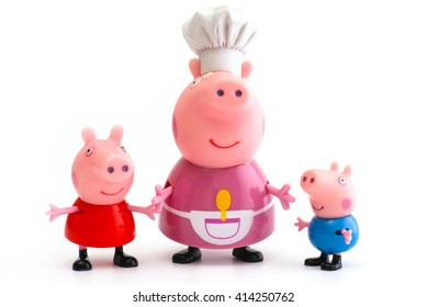 Tambov, Russian Federation - December 16, 2015 Peppa Pig, George Pig and Granny Pig toy characters on white background. Studio shot.