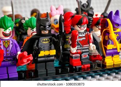 Tambov, Russian Federation - February 05, 2018 Lego minifigures standing in rows. In first row - Batman, The Joker, Harley Quinn, Batgirl. Gray baseplate background. Studio shot.