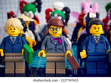 Tambov, Russian Federation - February 05, 2018 Lego minifigures standing in rows. Businesswoman and businessmen minifigures standing in front row. Studio shot.