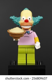Tambov, Russian Federation - February 07, 2015 Lego Krusty the Clown minifigure with pie on black background. The Simpsons Series. Studio shot. Adobe RGB.