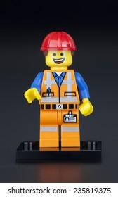 Tambov, Russian Federation - February 10, 2014 LEGO Hard Hat Emmet minifigure on black background. LEGO Movie series. Studio shot.