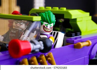 Tambov, Russian Federation - February 11, 2017 Lego The Joker and Harley Quinn minifigures in The Joker Notorious Lowrider car. Studio shot.
