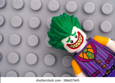 Tambov, Russian Federation - February 11, 2017 Lego Batman Movie minifigure -  The Joker on Lego gray baseplate background. Studio shot.