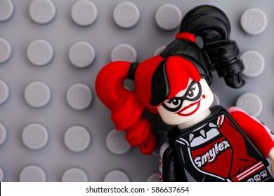 Tambov, Russian Federation - February 11, 2017 Lego Batman Movie minifigure - Harley Quinn on Lego gray baseplate background. Studio shot.