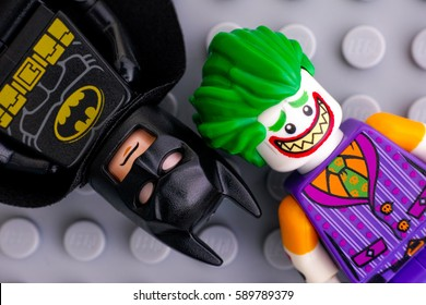 Tambov, Russian Federation - February 11, 2017 Two Lego Batman Movie minifigures - Batman and The Joker - on Lego gray baseplate background. Studio shot.