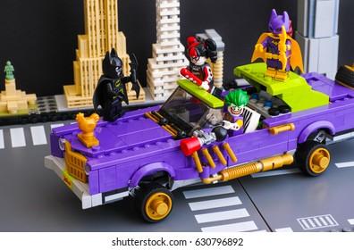 Tambov, Russian Federation - February 11, 2017 Lego Batman Movie. The Joker Notorious Lowrider in the city street with Batman, Batgirl, The Joker, Harley Quinn minifigures. Studio shot.